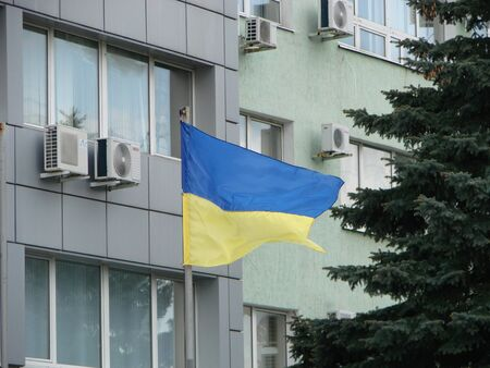 Yellow-blue flag of Ukraine on the facade of the building. Ukraine