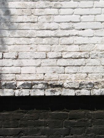 The brick texture with cracks and scratches as a background 写真素材