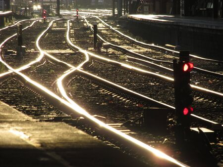 Golden sunlight reflecting off the train track at Flinders Street Station