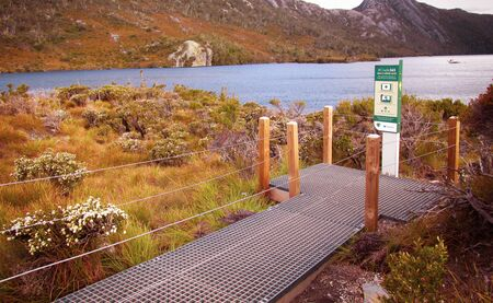 Foot trail for visitors at Cradle Mountain. Suitable to illustrate the benefit of exposure to nature. Immersion to nature is therapeutic, reduces stress, increases mental health and sense of community Stock fotó