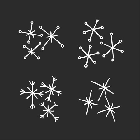 Hand drawn set of vintage snowflakes. White on black background. Abstract  doodle drawing snow. Vector retro art illustration Ilustração