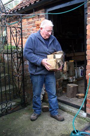 Man carrying firewood Stock Photo - 3785069