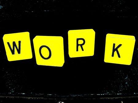 Work block wording yellow on black Stock Photo