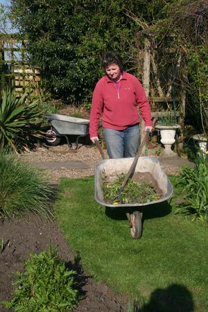 Woman pushing a wheelbarrow