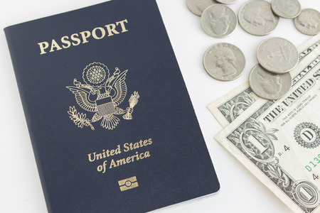 nickle: US passport and dollar bill, quarter, dime, nickle