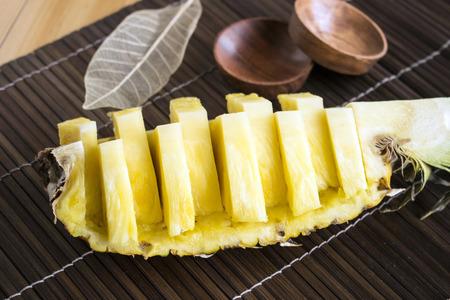 luncheon: Sliced ?????? flesh pineapple on bamboo luncheon mat Stock Photo
