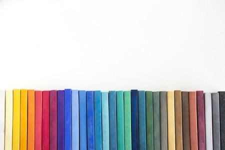 sketchbook: Colorful hard pastels line up on the sketchbook