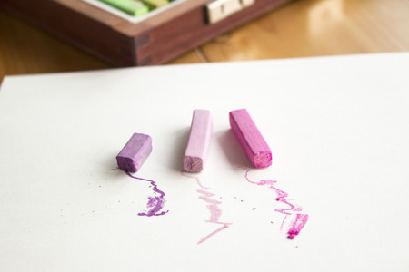 sketchbook: Pink and purple hard pastels on the sketchbook