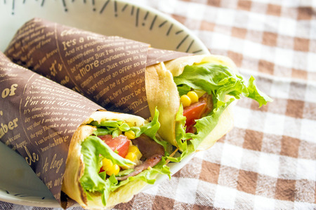 Summer vegetable (lettus,tomato,corn) salad wrapped in crepe 스톡 콘텐츠