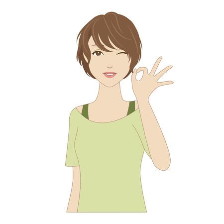 Winking jeune femme posant avec signe okey