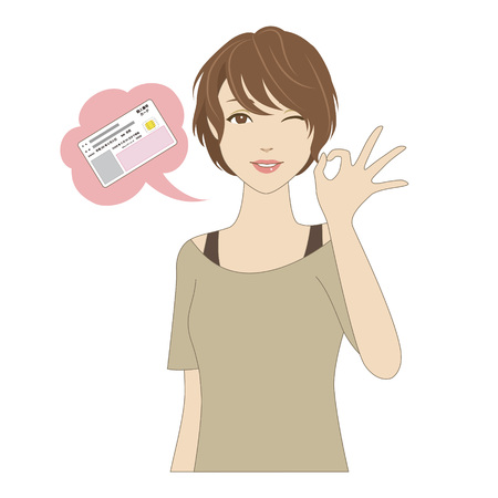 A smiling young woman with OK sign