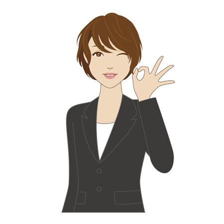 Winking young woman in business suit posing with okay sign