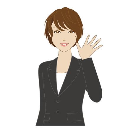 Une jeune femme souriante en costume d'affaires en agitant sa main