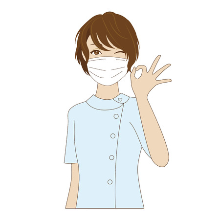 ok sign: Winking female dental assistant with surgical mask in uniform posing with OK sign
