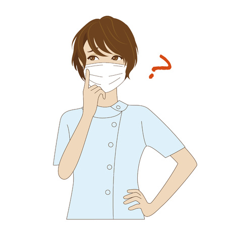 surgical mask: A thinking young female dental assistant with surgical mask in light blue uniform