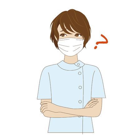 surgical mask: A thinking female young dental assistant with surgical mask