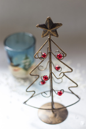 candle holder: Christmas tree made of wire and a glass candle holder Stock Photo