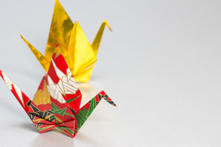 Origami Cranes Made Of Gold And Colroful Japanese Patterned Paper