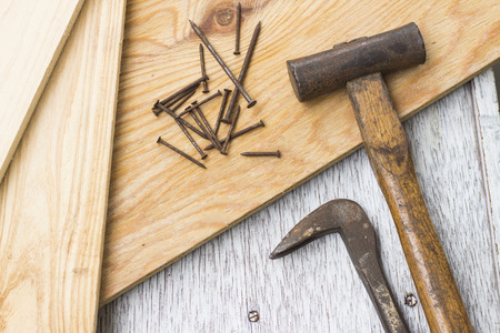 Wooden boards, Hammer, nail puller and nails, carpenter's tools 写真素材