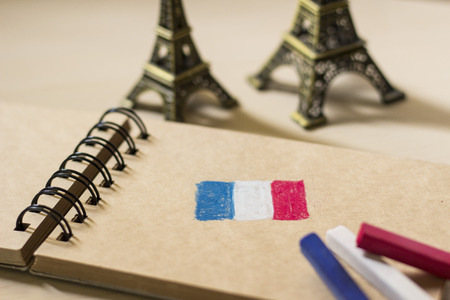 spiral binding: French flag drawing on the sketchbook and Eiffel tower Stock Photo