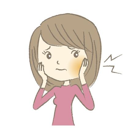 Mujer joven que tiene dolor de muelas