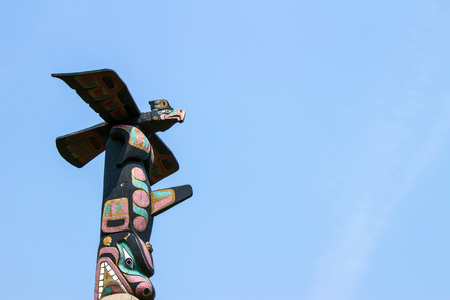Totem Pole in Canada, blue sky background