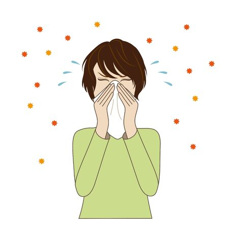 Young woman blowing her nose, hay fever