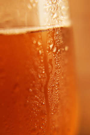 Close-up photo of cold beer poured into a glass