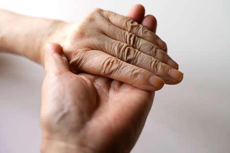 Senior women, grandma and daughter hands, handshakes