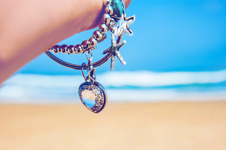 Charm by the blue sea. romantic bracelet with heart-shaped pendant crystal and sea stars.