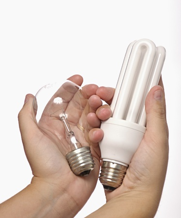compared: Hands holding traditional bulb and low power