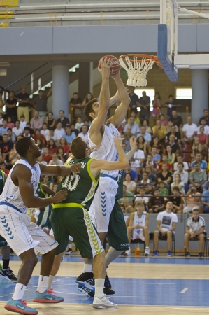 CORDOBA,  SPAIN - SEPTEMBER 9: Juanjo Triguero (W 5) in action During match, Cup Andalucia 2012, Unicaja (G) vs Cajasol (W) (65-53) at Vistalegre sports hall, on September 9, 2012 in Cordoba Spain
