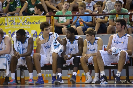 CORDOBA, SPAIN - SEPTEMBER 9: players on the bench During match, Cup Andalucia 2012, Unicaja (G) vs Cajasol (W) (65-53) at Vistalegre sports hall, on September 9, 2012 in Cordoba Spain Editorial