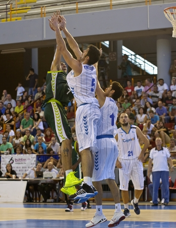 CORDOBA,  SPAIN - SEPTEMBER 9: Augusto Lima (G 7) in action During match, Cup Andalucia 2012, Unicaja (G) vs Cajasol (W) (65-53) at Vistalegre sports hall, on September 9, 2012 in Cordoba Spain