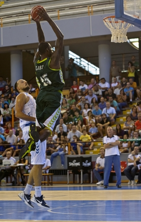 gist: CORDOBA,  SPAIN - SEPTEMBER 9: James Gist (G 15) in action During match, Cup Andalucia 2012, Unicaja (G) vs Cajasol (W) (65-53) at Vistalegre sports hall, on September 9, 2012 in Cordoba Spain