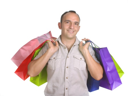 smiling man with several shopping bags  on white background