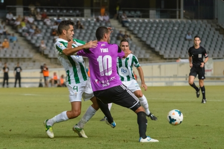 CORDOBA, SPAIN - AUGUST 18: Iago Bouz�n W(4) in action during match league Cordoba (W) vs Ponferradina (B)(1-0) at the Municipal Stadium of the Archangel on august 18, 2013 in Cordoba Spain
