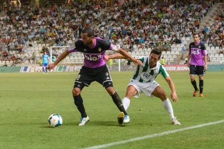 CORDOBA, SPAIN - AUGUST 18:  Yuri  B(10) in action during match league Cordoba (W) vs Ponferradina (B)(1-0) at the Municipal Stadium of the Archangel on august 18, 2013 in Cordoba Spain