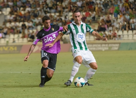 CORDOBA, SPAIN - AUGUST 18: Abel G�mez W(23) in action during match league Cordoba (W) vs Ponferradina (B)(1-0) at the Municipal Stadium of the Archangel on august 18, 2013 in Cordoba Spain