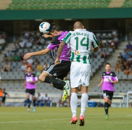 CORDOBA, SPAIN - AUGUST 18:  Ra�l Bravo W(14) in action during match league Cordoba (W) vs Ponferradina (B)(1-0) at the Municipal Stadium of the Archangel on august 18, 2013 in Cordoba Spain