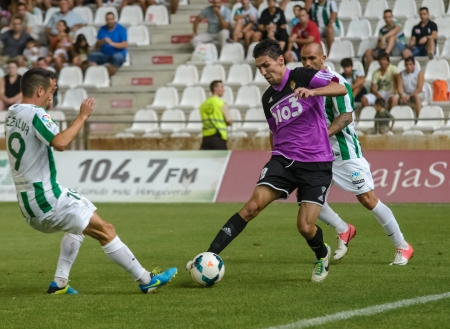 CORDOBA, SPAIN - AUGUST 18:  Óscar Ramírez B(20) in action during match league Cordoba (W) vs Ponferradina (B)(1-0) at the Municipal Stadium of the Archangel on august 18, 2013 in Cordoba Spain