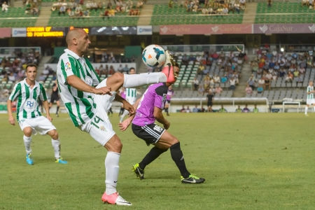 CORDOBA, SPAIN - AUGUST 18:  R�ul Bravo W(14) in action during match league Cordoba (W) vs Ponferradina (B)(1-0) at the Municipal Stadium of the Archangel on august 18, 2013 in Cordoba Spain  Editorial