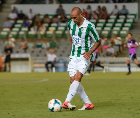 CORDOBA, SPAIN - AUGUST 18:  Rául Bravo W(14) in action during match league Cordoba (W) vs Ponferradina (B)(1-0) at the Municipal Stadium of the Archangel on august 18, 2013 in Cordoba Spain