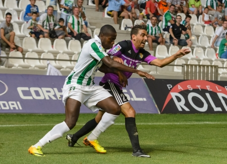 CORDOBA, SPAIN - AUGUST 18:  Ayina John W(11) in action during match league Cordoba (W) vs Ponferradina (B)(1-0) at the Municipal Stadium of the Archangel on august 18, 2013 in Cordoba Spain
