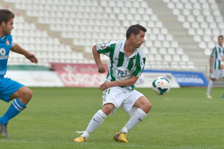 CORDOBA, SPAIN - SEPTEMBER 29:  Carlos Caballero W(21) in action during match league Cordoba (W) vs Girona (B)(2-0) at the Municipal Stadium of the Archangel on September 29, 2013 in Cordoba Spain Editorial