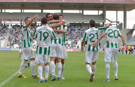 CORDOBA, SPAIN - SEPTEMBER 29:  C�rdoba players celebrating goal action during match league Cordoba (W) vs Girona (B)(2-0) at the Municipal Stadium of the Archangel on September 29, 2013 in Cordoba Spain