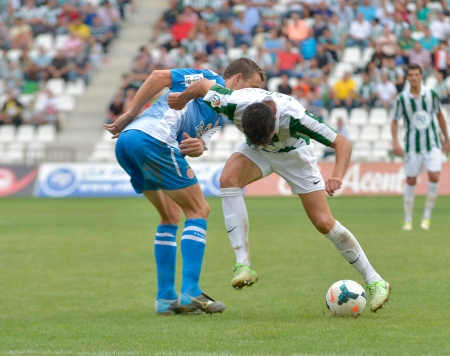 CORDOBA, SPAIN - SEPTEMBER 29: Daniel Espejo W(31) in action during match league Cordoba (W) vs Girona (B)(2-0) at the Municipal Stadium of the Archangel on September 29, 2013 in Cordoba Spain