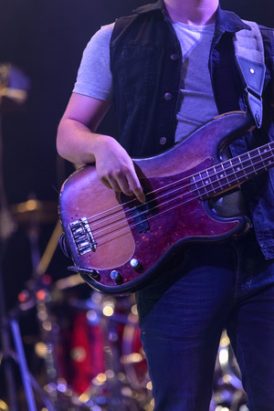 Bass guitarist playing during a concert