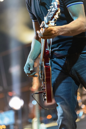 Guitarist playing during a concert  Stock Photo