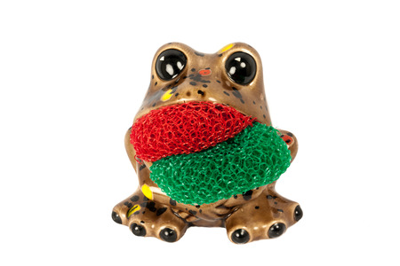 scrubber: Brown Frog That Serves As A Dish Scrubber  Pad Isolated On A White Background Stock Photo